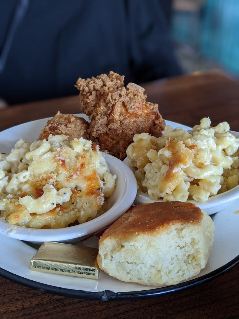 two servings of mac and cheese, with a biscuit and piece of fried chicken at Libby's in Covington, Ky.