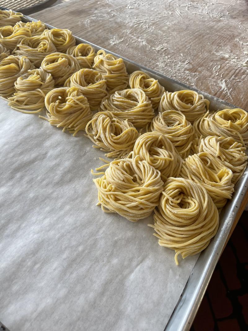 Fresh pasta on a tray.