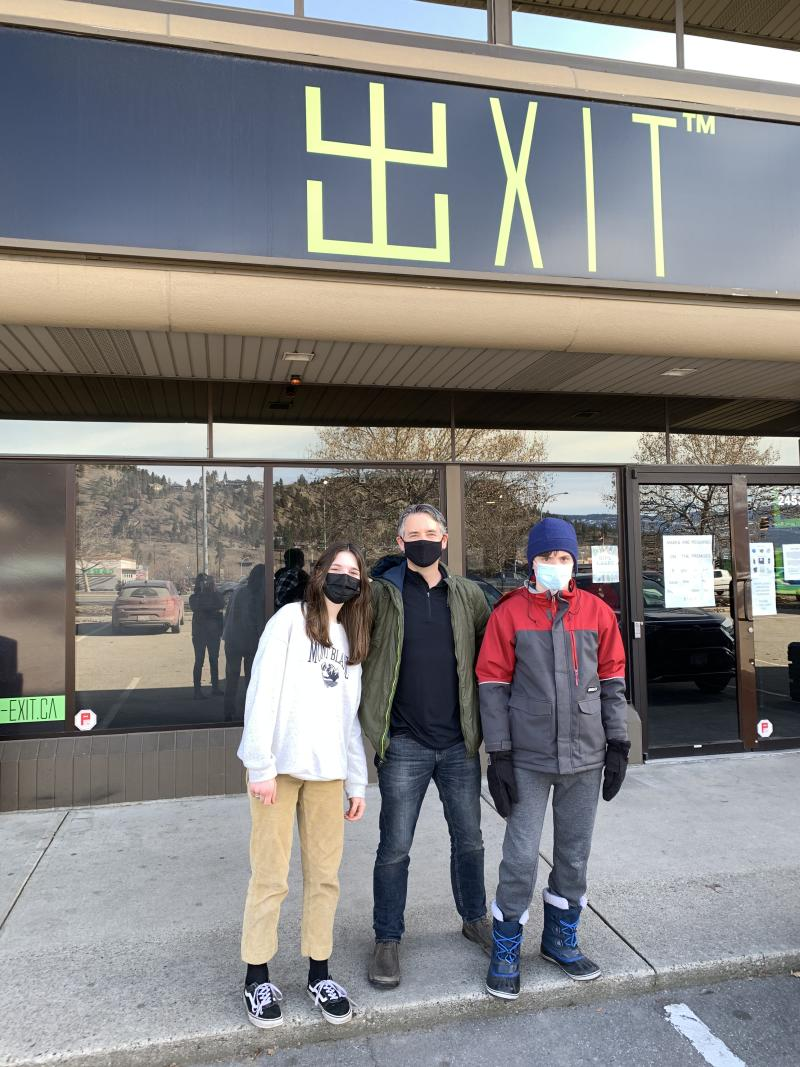 Exit Kelowna - Lisa's Family in front of the building