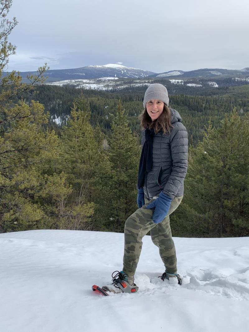 Lisa Kadane Snowshoeing with Big White Mountain in Background