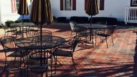 empty patio with tables and chairs at Hidden Jules Cafe