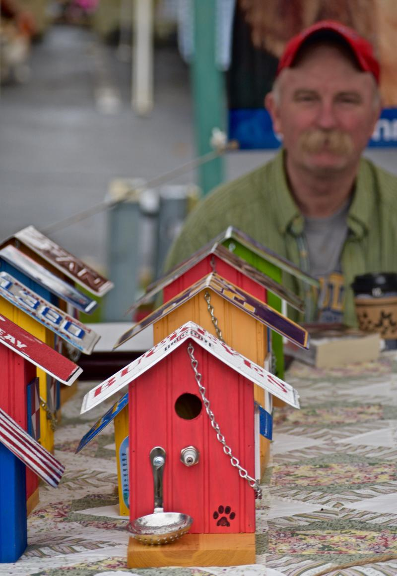 handmade bird houses at an open air market