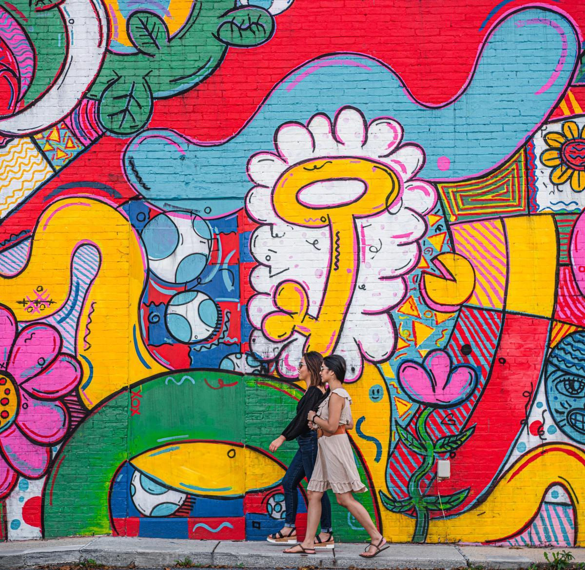 Ladies walking beside Mural in New Cumberland