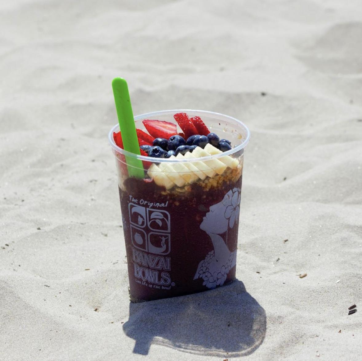 Banzai Bowl acai bowl in the beach sand