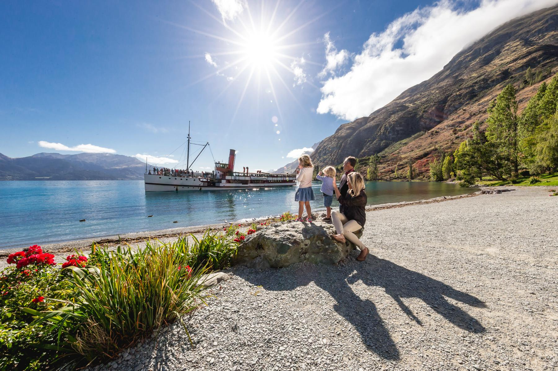 Family at Walter Peak watching the TSS Earnslaw steamship