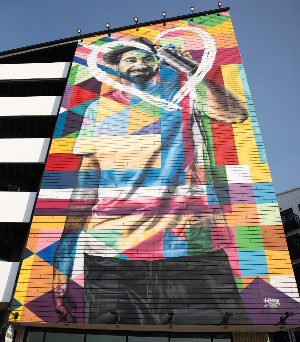 Five-story self-portrat of Eduardo Kobra on the side of Gravity Columbus