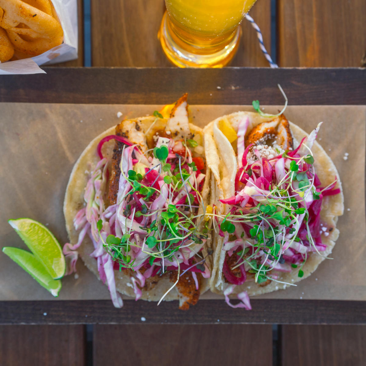 Tacos and beer on table