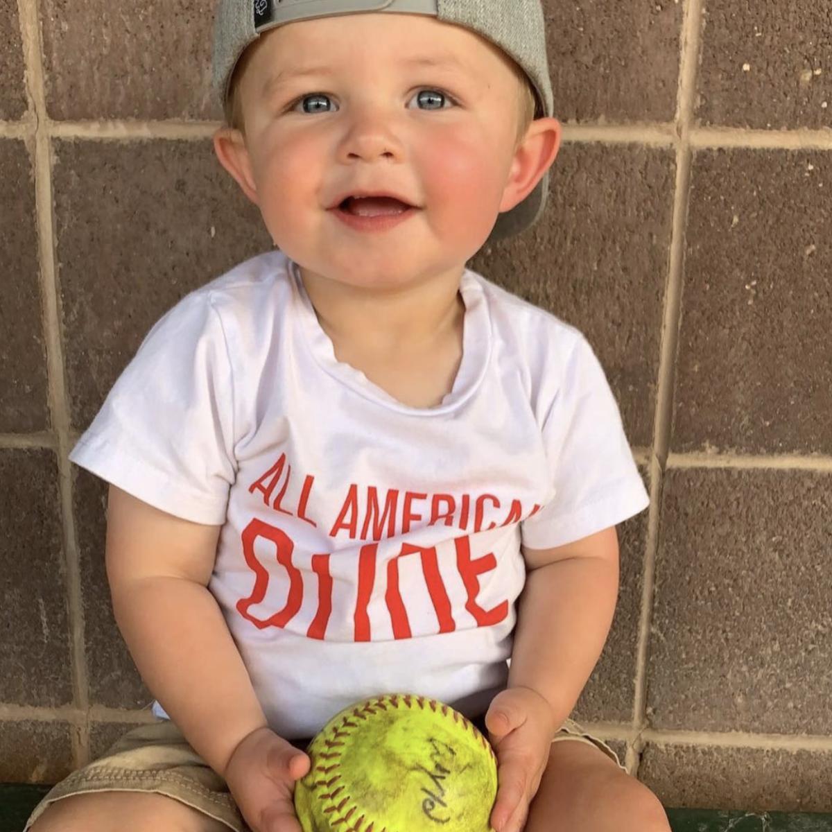 Baby holding a baseball