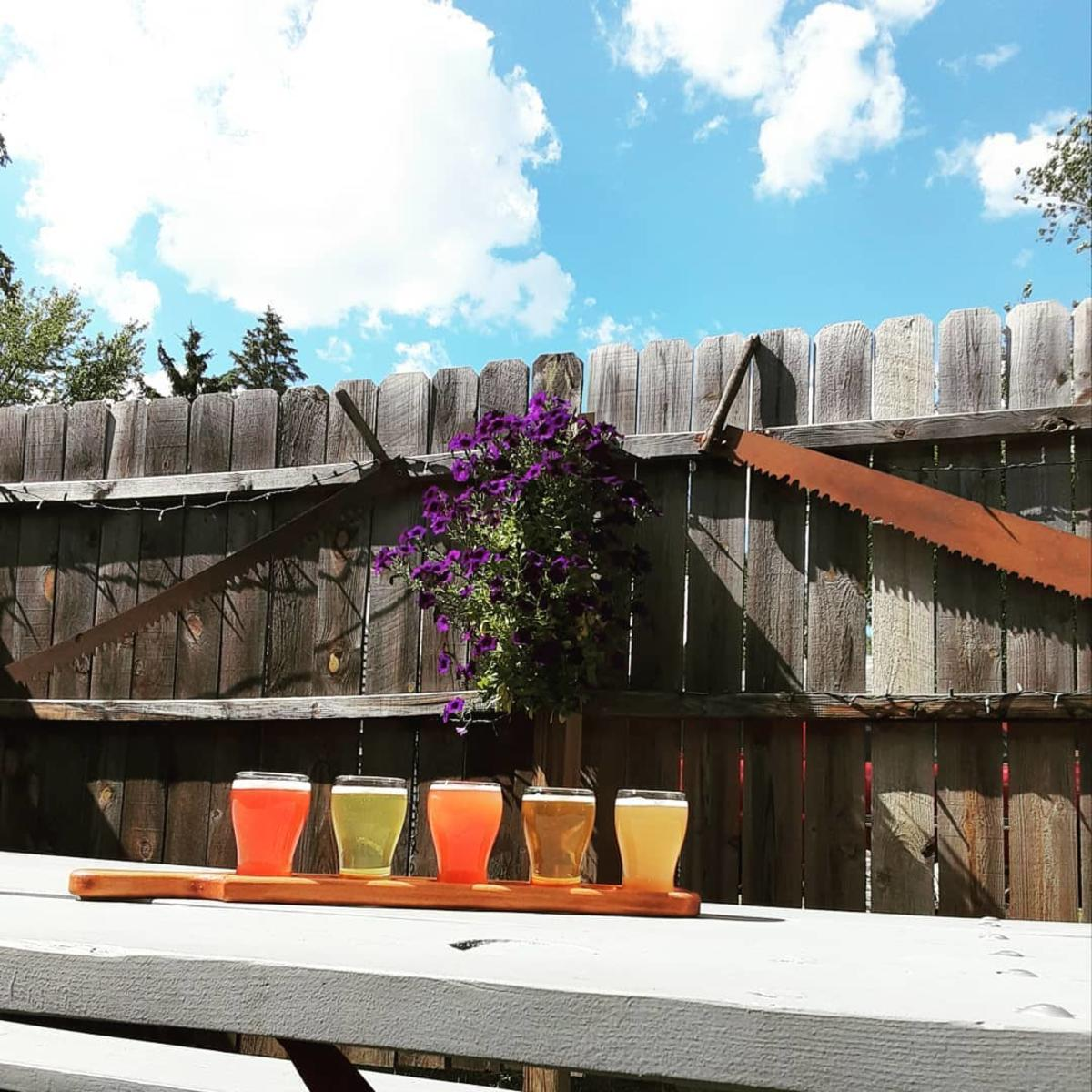 Summery beer flight served on the back patio of Loggers Brewing Company in Shields