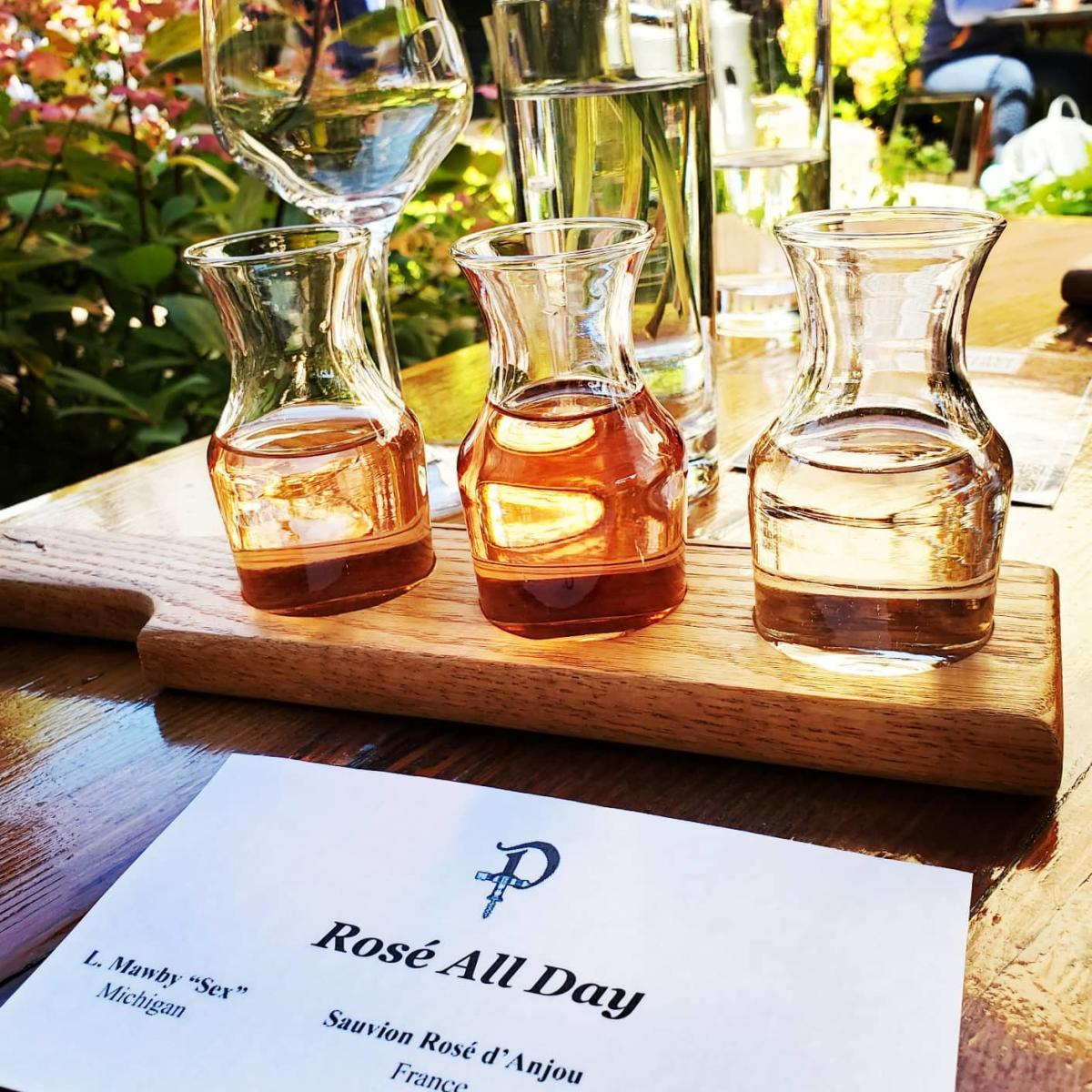 Rose All Day wine flight on the patio at Prost Wine Bar & Charcuterie in Frankenmuth