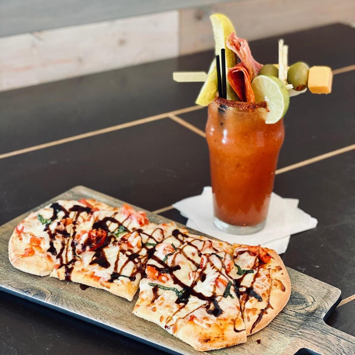 Margherita flatbread pizza with a bloody mary at Tavern 101 in Bay City