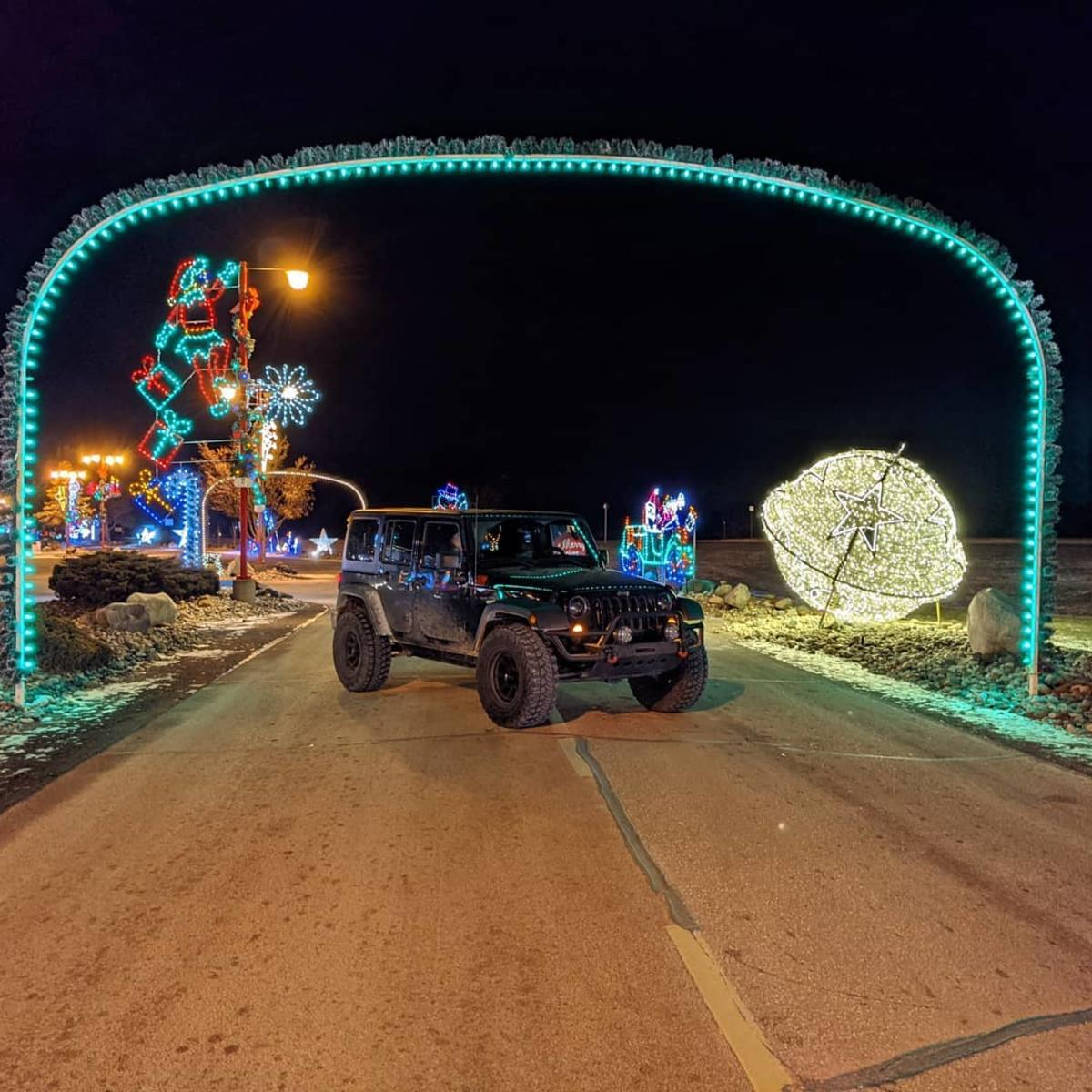 Jeep paused under an archway of lights while driving through the holiday light show along 25 Christmas Lane, outside of Bronner's CHRISTmas Wonderland in Frankenmuth