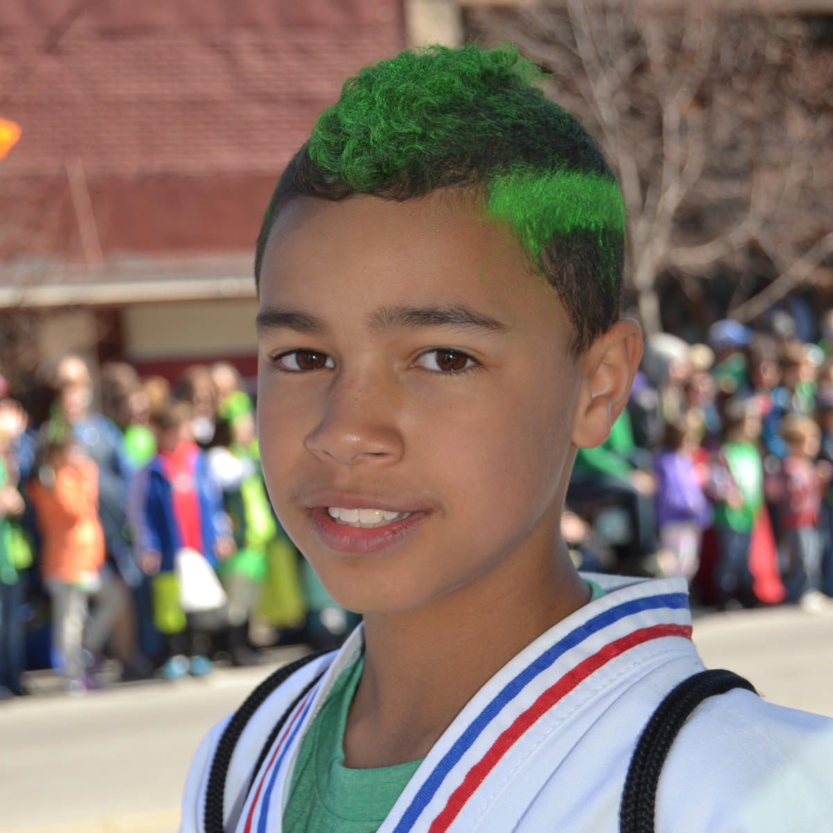 St. Patrick's Day Parade boy with green hair