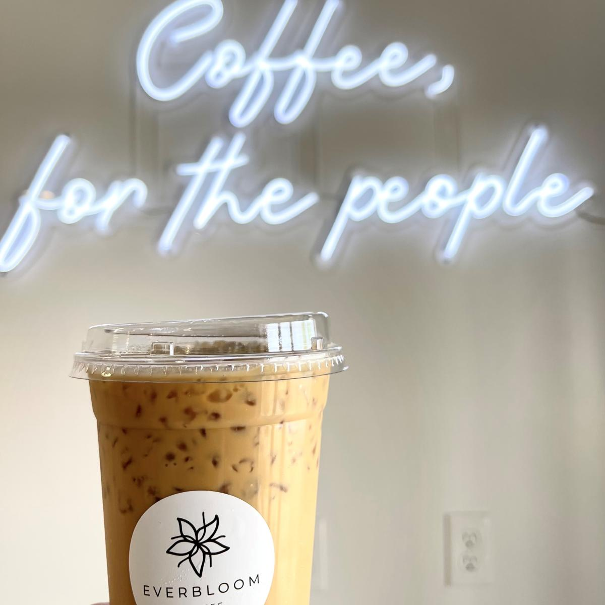 Everbloom Coffee with 'Coffee for the people' sign