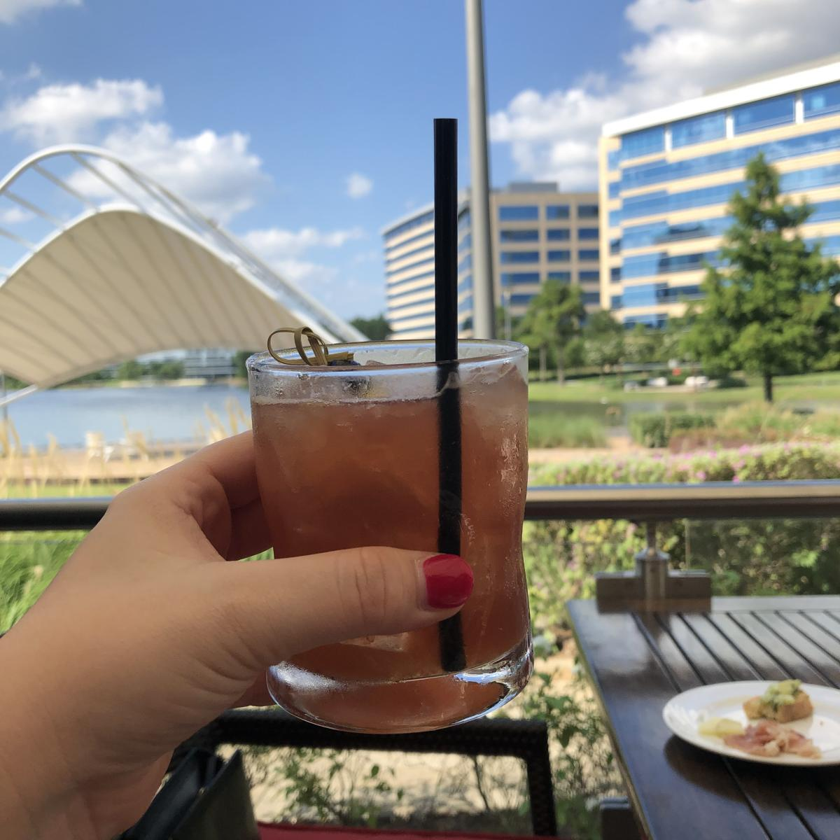 Cocktail from Fogo de Chao with view of Lake Woodlands