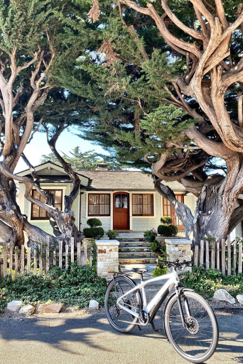 Electric bicycle parked in front of a beautiful home in Carmel.