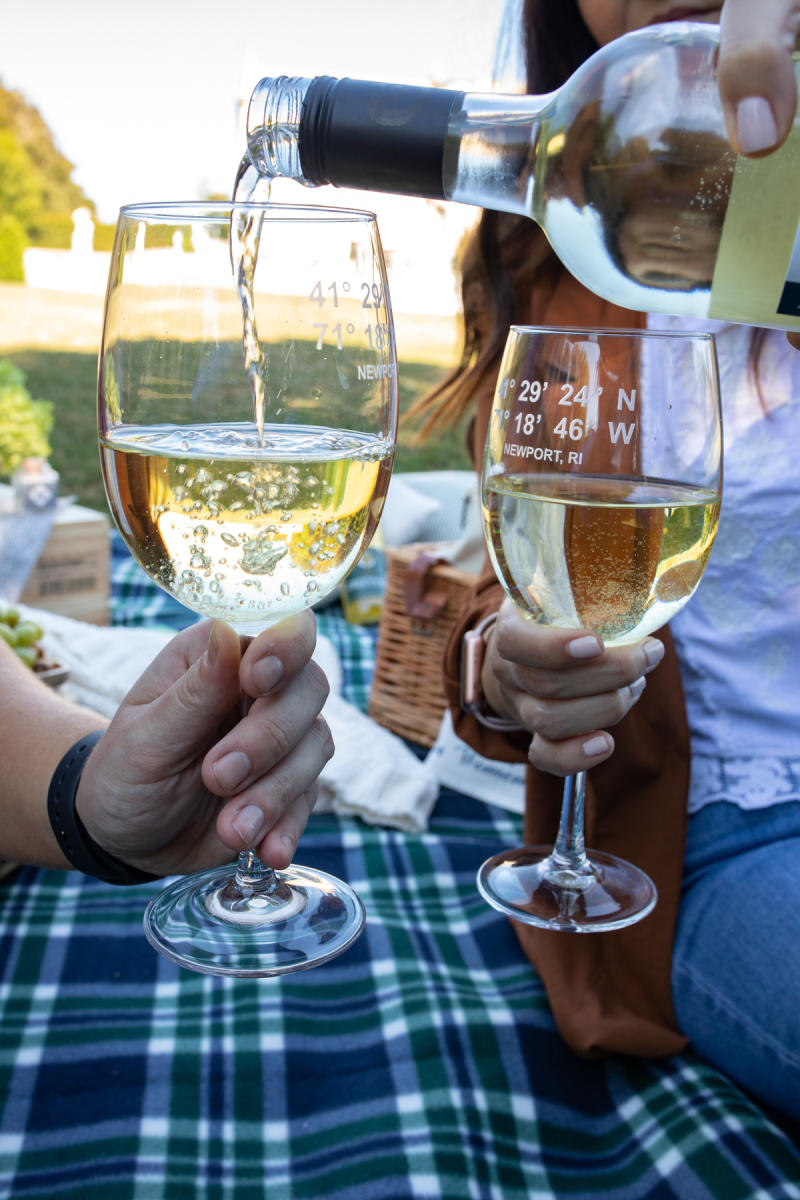 Two People With White Wine Glasses At A Newport Mansions Picnic