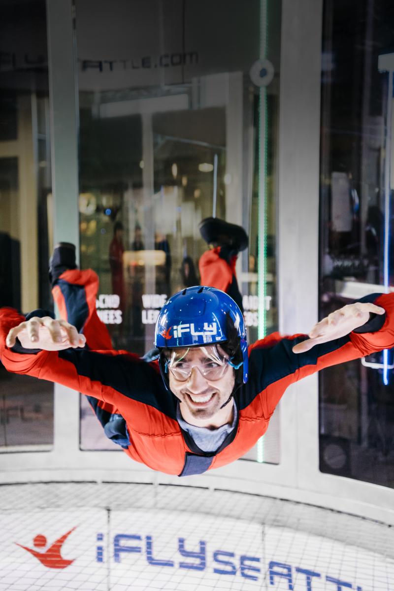 iFLY Indoor Skydiving in Tukwila, man flying in wind tunnel