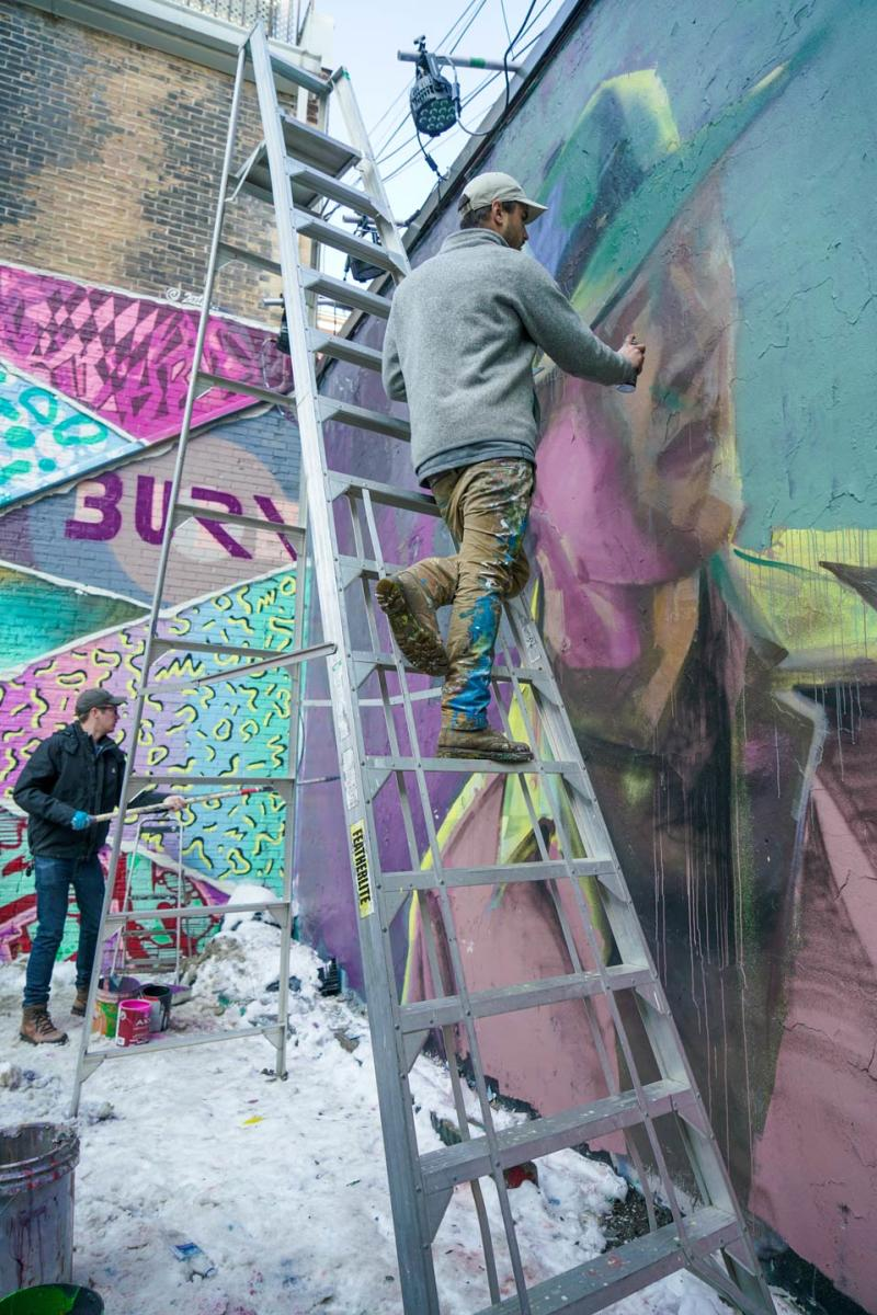 tourism-toronto-to-glows-glowing-street-art-being-painted-by-emmanuel-jarus-photo-by-arienne-parzei