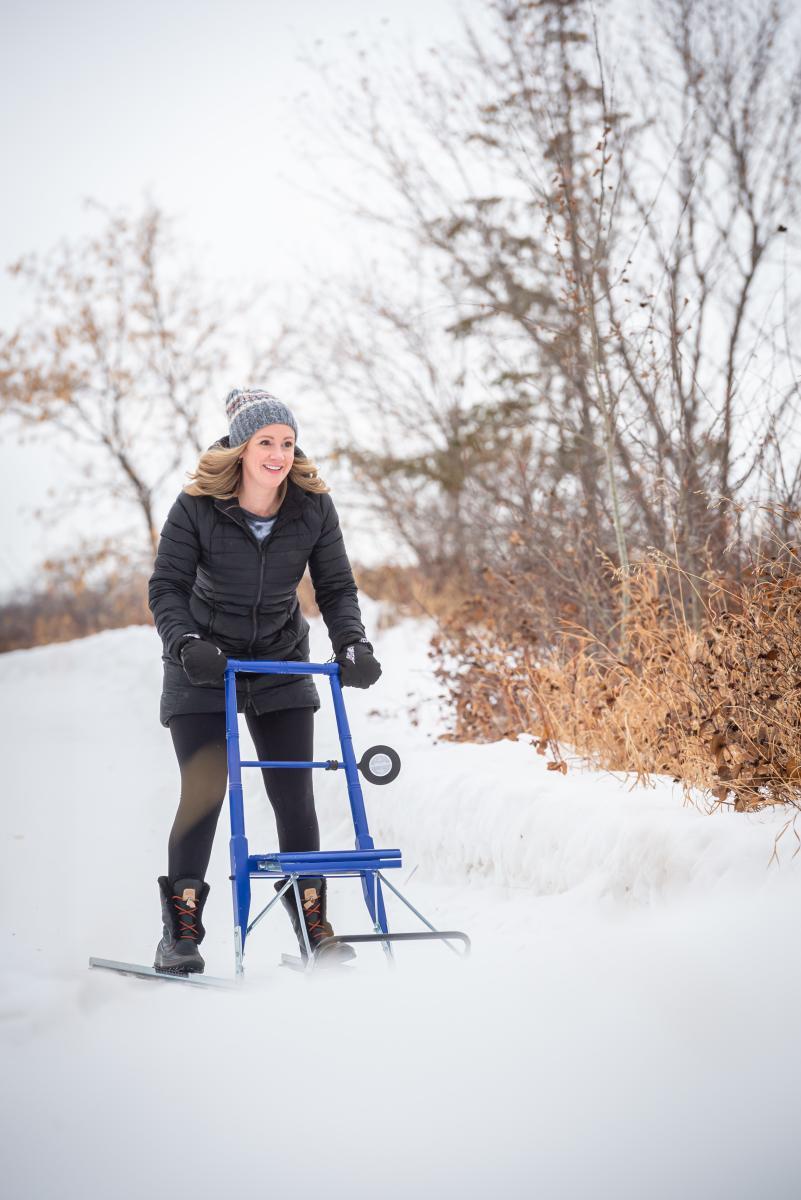 A woman enjoys a day of kicksledding outside of Saskatoon.