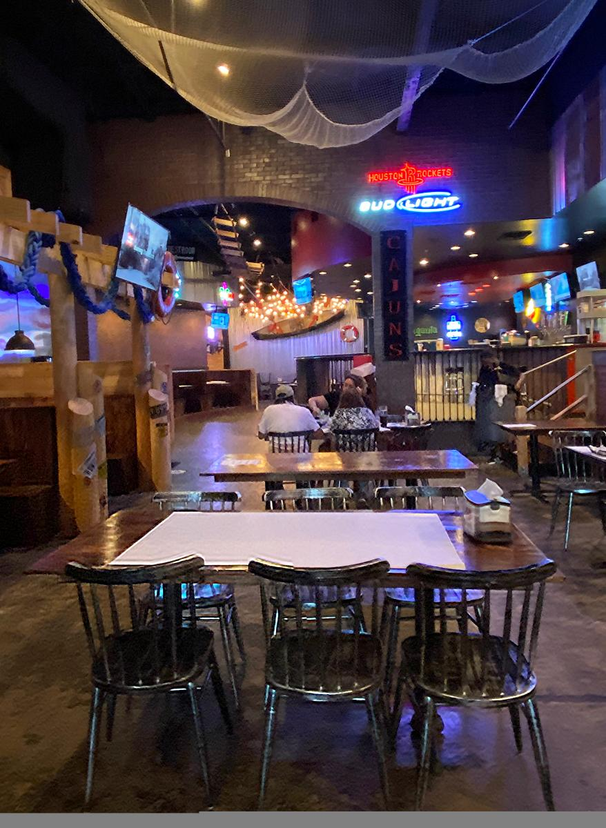 The dining area of Rock n Crab in Beaumont is a well-lit space with homestyle dining tables.
