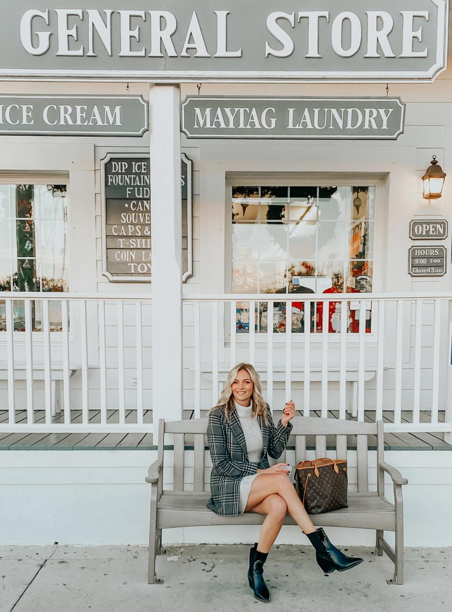 The Coastal Blonde poses for a picture in front of Beaufort's beloved General Store.