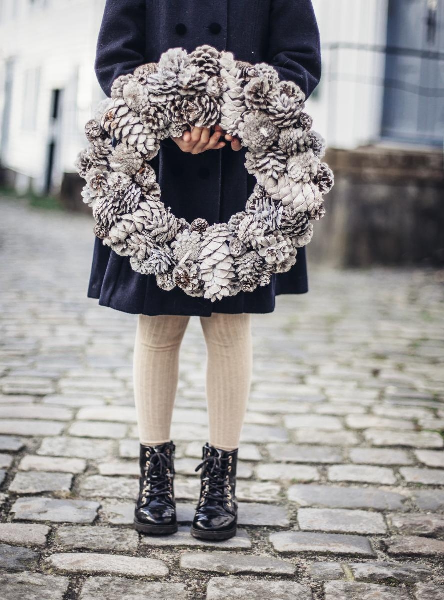 Girl holding a Christmas decorations