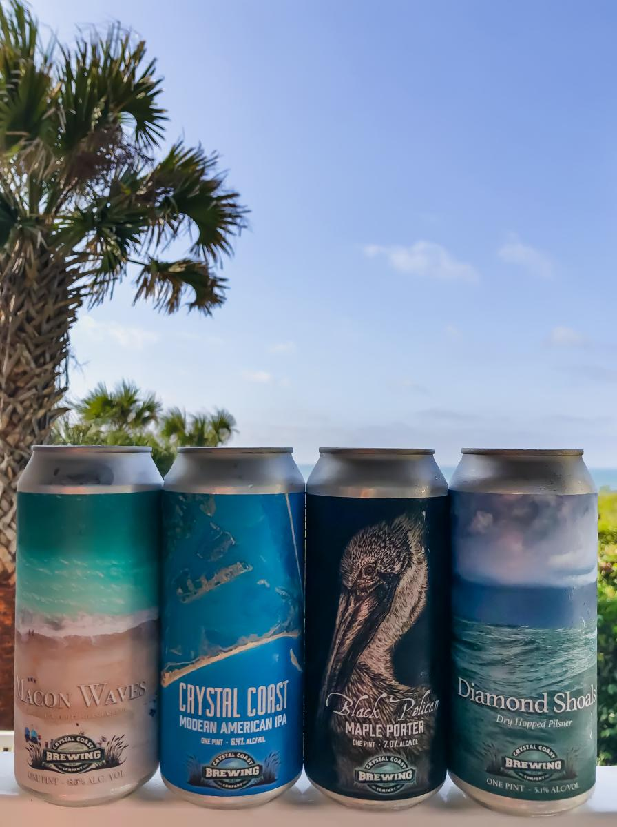 Assorted cans of beer from Crystal Coast Brewing Company