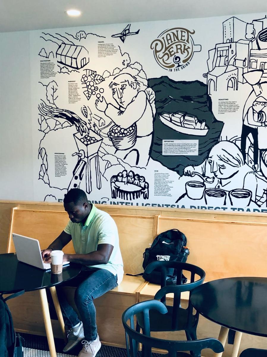 Muzi Studying at Planet Perk in the Grind