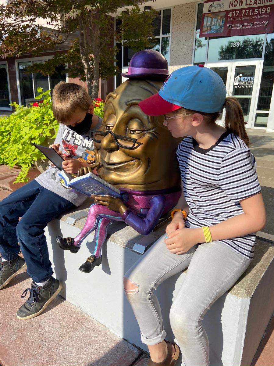 Kids reading by Sculpture Walk