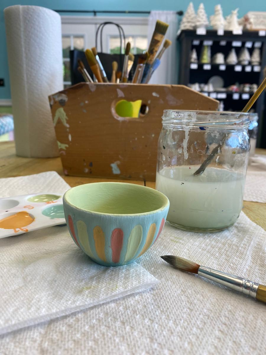 paid and supplies with a small painted pottery bowl