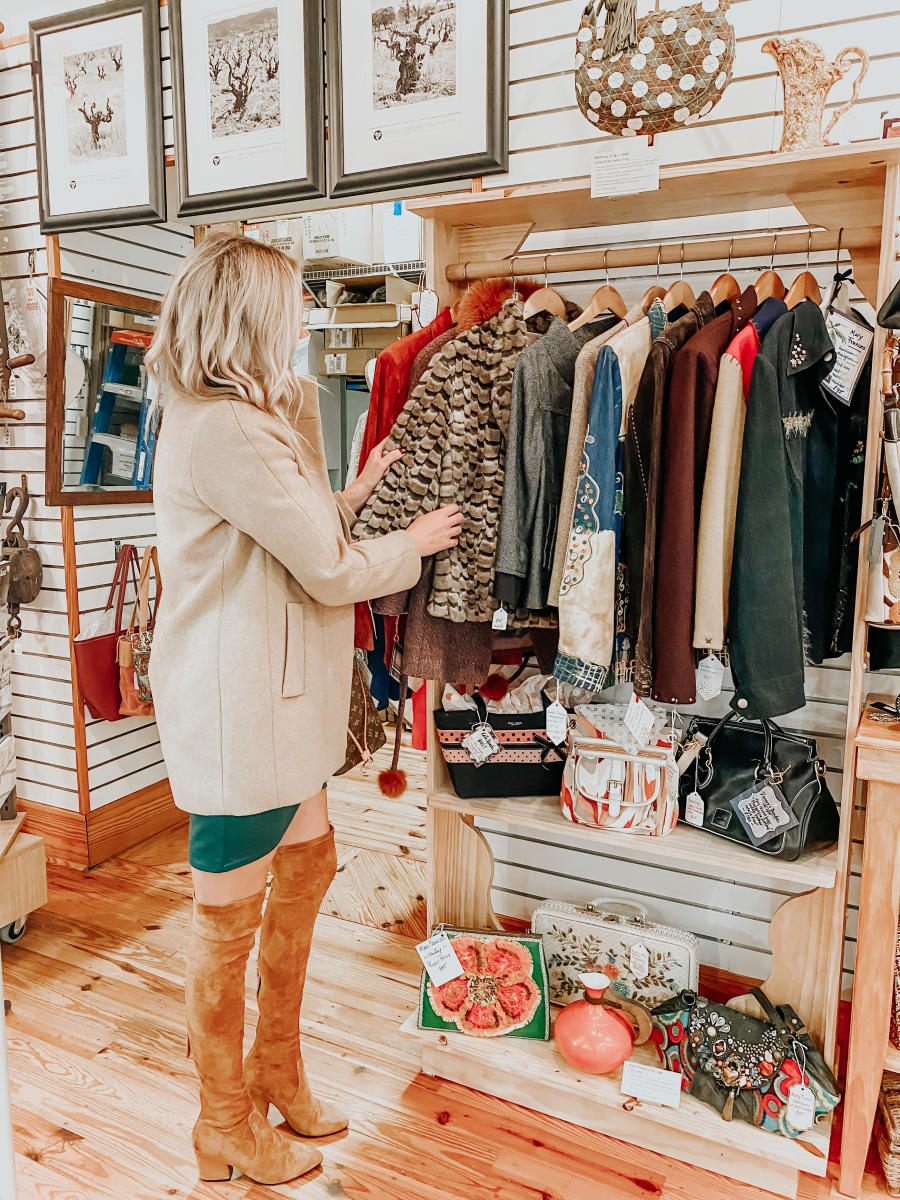 The Coastal Blonde looks through the racks on a shopping trip to Beaufort Mercantile Company.