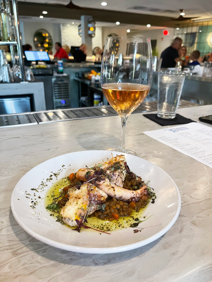 Grilled octopus and a glass of wine at Yianni's Taverna in Bethlehem