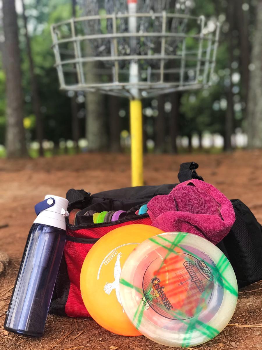 Disc Golf Gear and Hole Photo