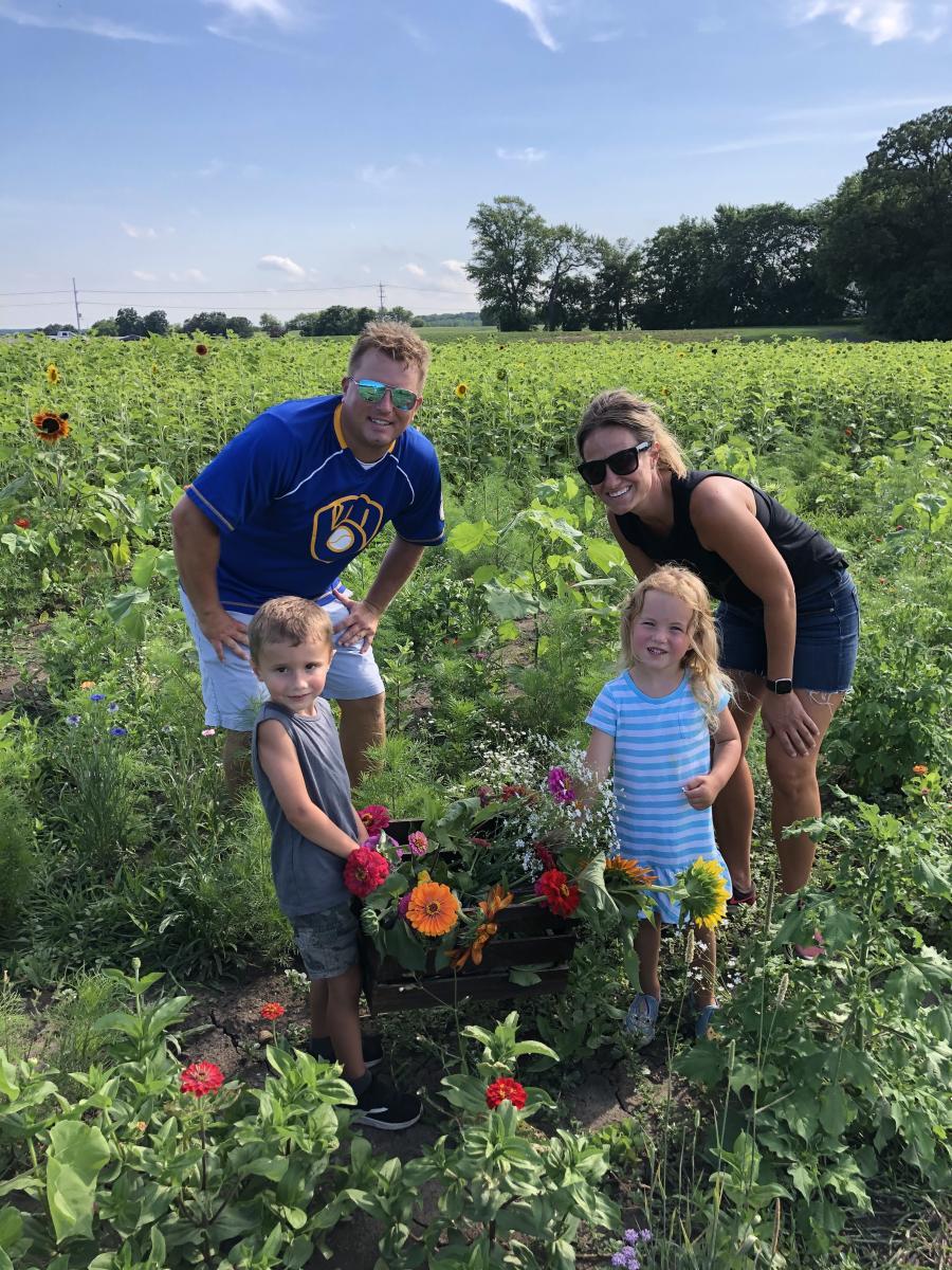 Thompson Strawberry Farm - Family Picking Wild Flowers