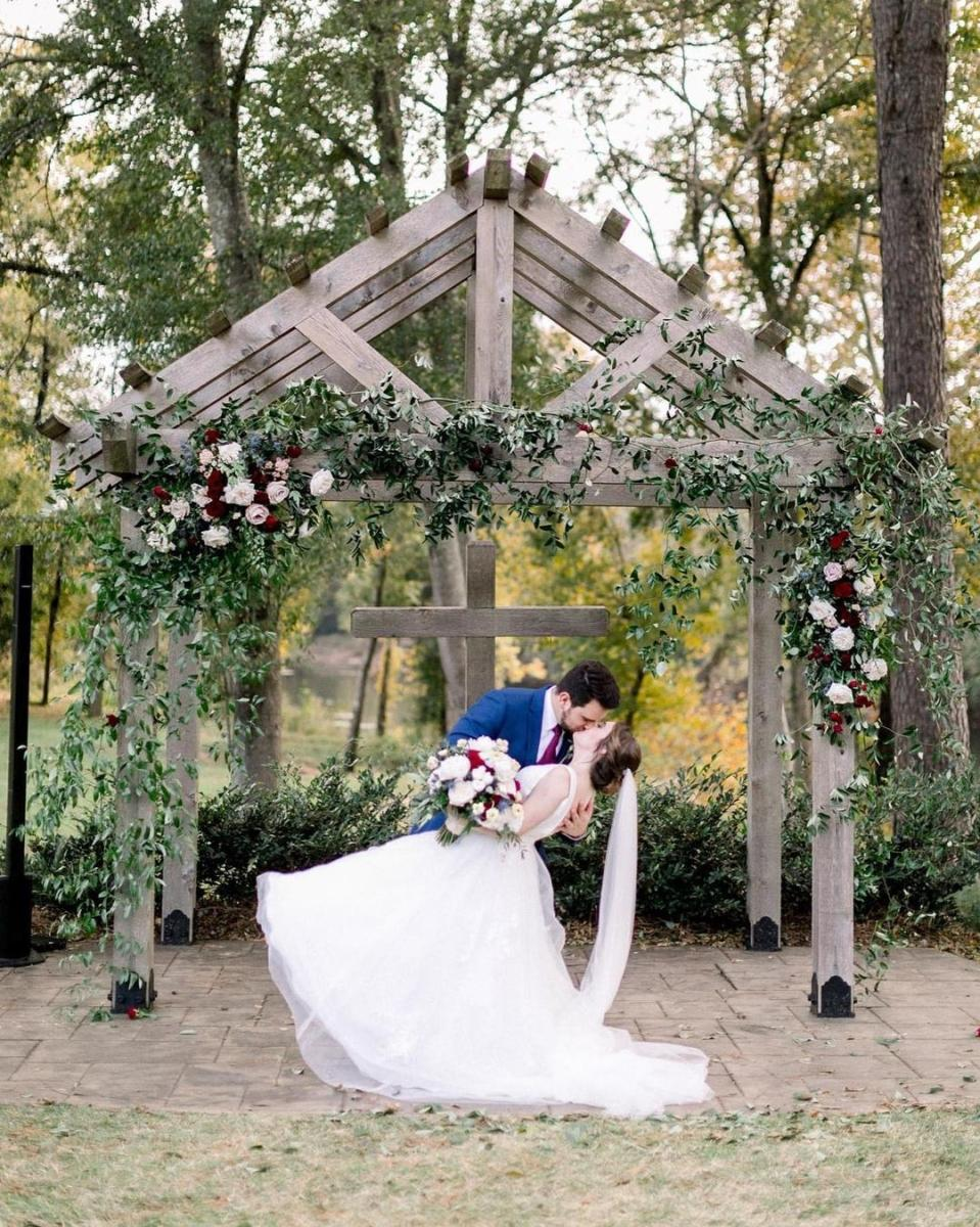 Bride and Groom Kissing At Adam's Acres in Milledgeville, GA