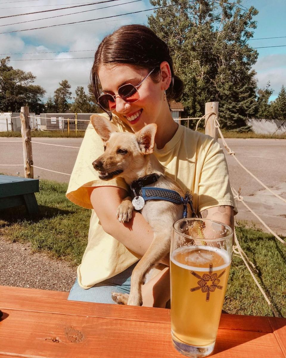 A woman and her pup enjoying the patio at Drifia Brewery