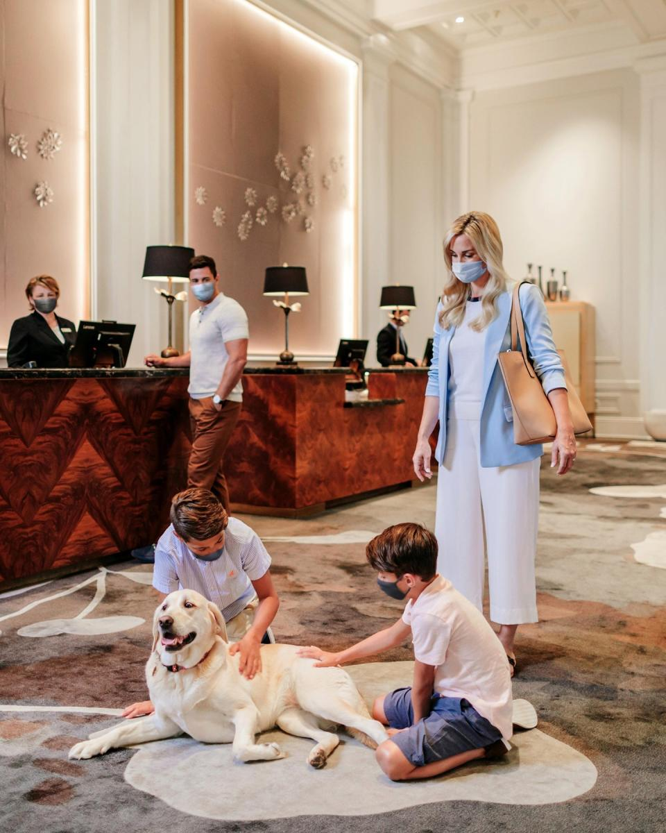 Family with dog in the Claremont Hotel Lobby