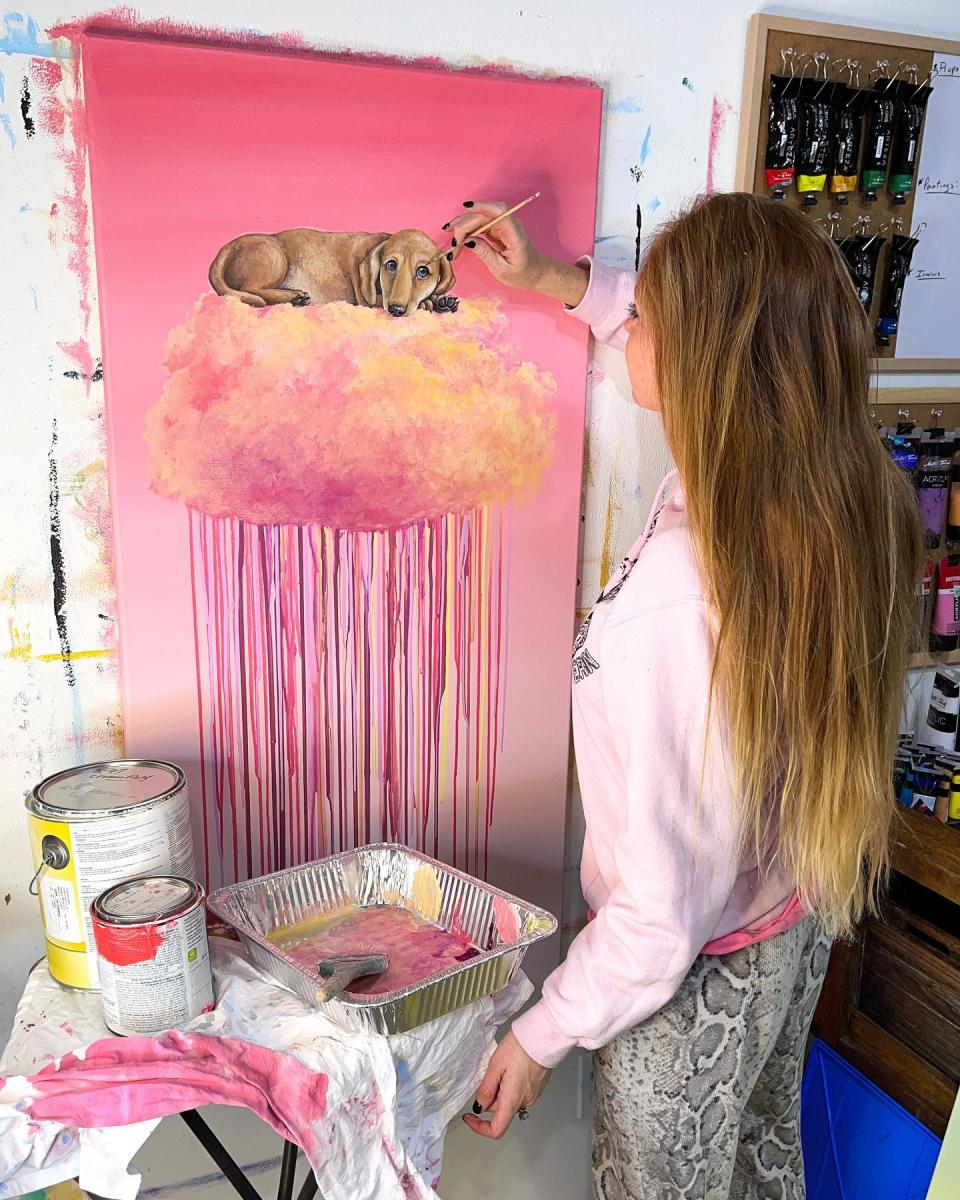 Andrea Ehrhardt Painting one of her famous cloud art