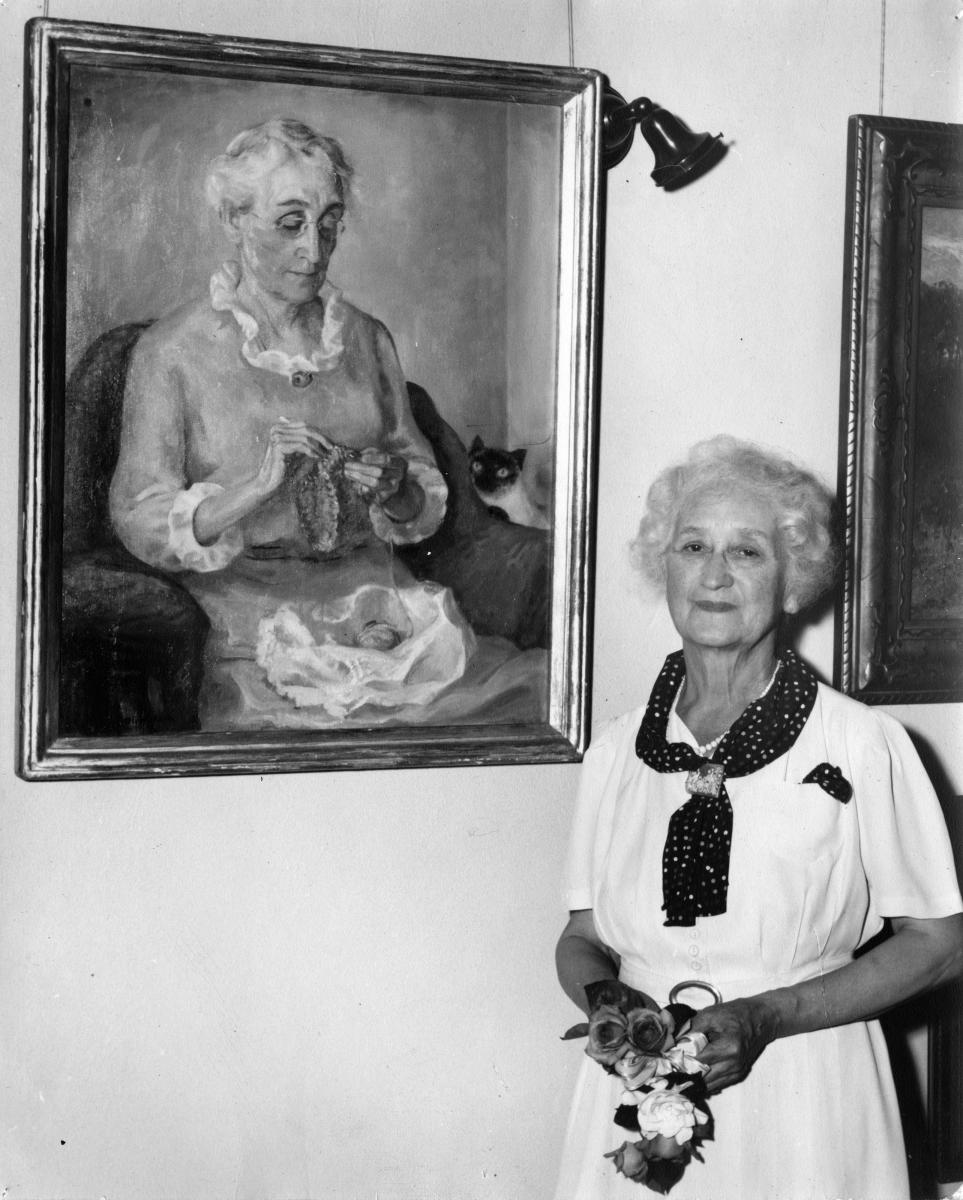 Olive Rush with portrait of Emma Beasley, taken when Rush received an honorary Doctor of Arts degree from Earlham College, Richmond, Indiana around 1947, New Mexico Magazine