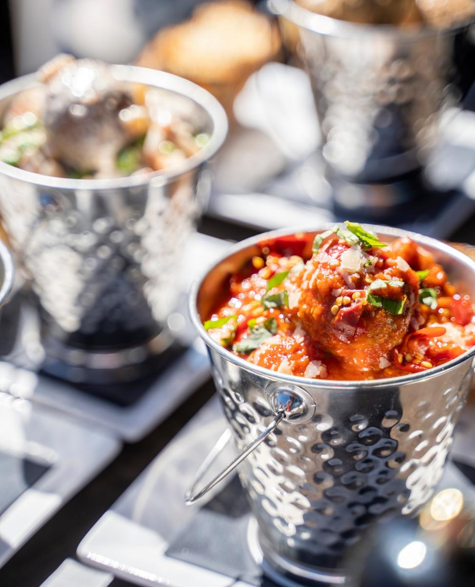 Small metal pails of meatballs in sauce from The Sicilian Butcher in Chandler, AZ