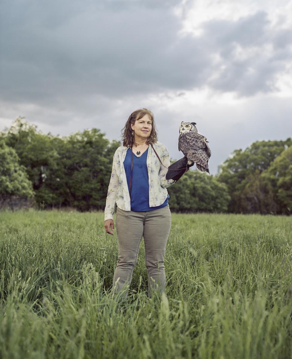 Volunteer holding owl at the Santa Fe Raptor Center