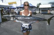 Woman holding fish at tournament