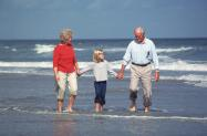 Grandparents with granddaughter at Wilmington, NC Beach