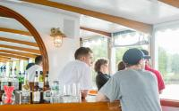 Guests enjoy the bar on the Charles River Cruise