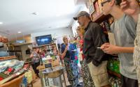 Guests taste olive oil during a walking tour of North End eateries