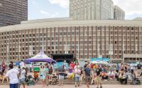 City Hall Plaza on a busy summer afternoon