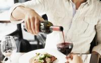 Dining - man pouring wine