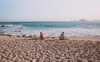 Surfers Sitting on Beach