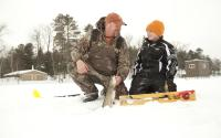 Father and son ice fish